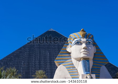LAS VEGAS - FEB 26: The Luxor hotel and casino on February 26 2013 , The hotel located on the Las Vegas Strip, contains a total of 4,400 rooms lining the interior walls of a pyramid style tower - stock photo