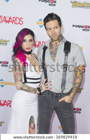 LAS VEGAS - JAN 23 : Adult film actress and co-host Joanna Angel (L) and adult film actor Small Hands attend the 2016 AVN Awards at the Hard Rock Hotel on January 23, 2016 in Las Vegas, Nevada.  - stock photo