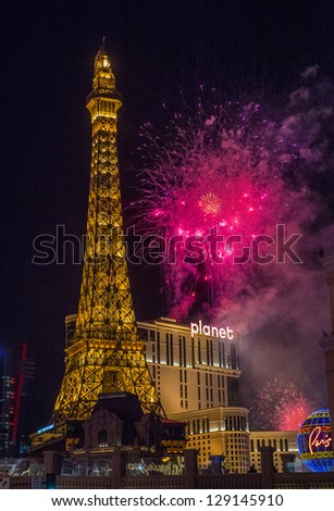 LAS VEGAS - JANUARY 01: New Year's fireworks near Paris hotel on January 01, 2013 in Las Vegas. Las Vegas in 2012 broke the all-time visitor volume record of 39-plus million visitors - stock photo