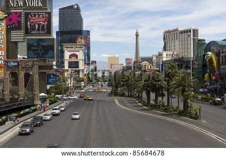 LAS VEGAS - JULY 28: A view of Las Vegas strip on July 28, 2011 in Las Vegas, Nevada. The strip is approximately 4.2 mi (6.8 km) long. - stock photo