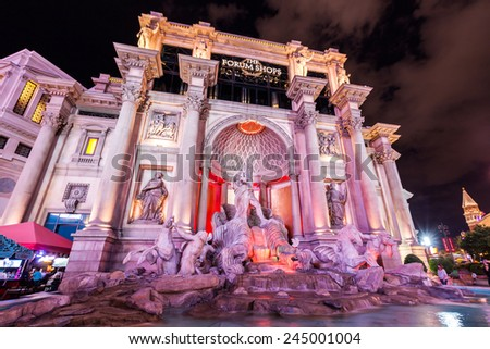 LAS VEGAS - JULY 6: Caesars Palace exterior by night on July 6, 2011. Its a AAA Four Diamond luxury hotel and casino located on the Las Vegas Strip including a convention facility of over 300,000 SF. - stock photo