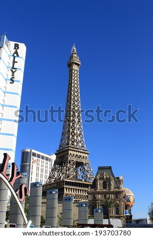 LAS VEGAS - JULY 4: Eiffel Tower at Paris Hotel and Casino on July 4, 2012 in Las Vegas, Nevada. Opened in 1999, the hotel has 2,915 rooms and also features a replicas of the Montgolfier Balloon. - stock photo