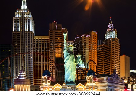 LAS VEGAS - JULY 8 2015: New York-New York located on the Las Vegas Strip is shown in Las Vegas. Replica of the Statue of Liberty is 150 ft (46 m) and the property opened in 1997. - stock photo