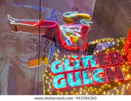 LAS VEGAS - JUNE 18 : Cowgirl neon sign in downtown Las Vegas on June 18 2016. The iconic sign of Glitter Gulch is placed in 20 East Fremont Street, in Downtown Las Vegas - stock photo