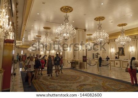 LAS VEGAS - JUNE 26: Paris Hotel on June 26, 2013  in Las Vegas. The Vegas Eiffel Tower was designed to be full scale, but the airport was too close and the tower had to be shrunk by 50%. - stock photo