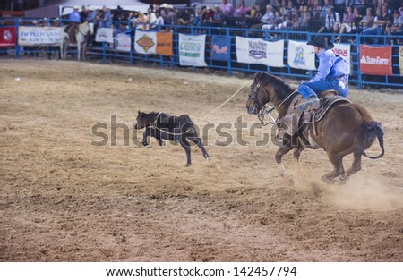 LAS VEGAS - MAY 17 : Cowboy Participant in a Calf roping Competition at the Helldorado Days Professional Rodeo in Las Vegas , USA on May 17 2013