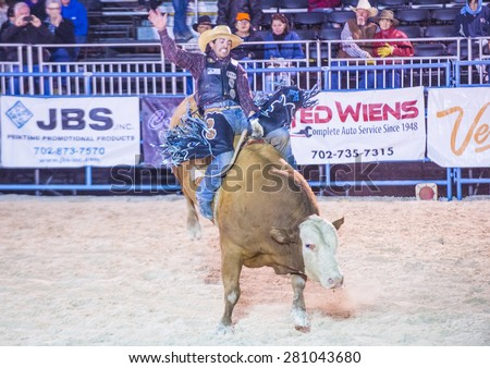 LAS VEGAS - MAY 16 : Cowboy Participating in a Bull riding Competition at the Helldorado days Rodeo , A professional Rodeo held in Las Vegas , Nevada on May 16 , 2015 - stock photo