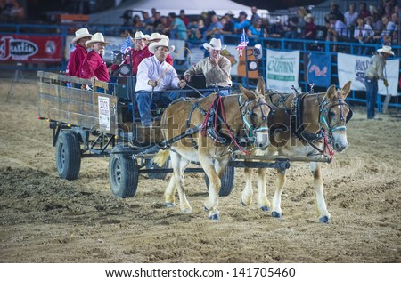 LAS VEGAS - MAY 17 : Cowboys on a wagon pulled by mules at the opening ceremony of the Helldorado Days Professional Rodeo in Las Vegas , USA on May 17 2013 - stock photo