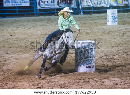 LAS VEGAS - MAY 16 : Cowgirl Participating in a Barrel racing competition at the Helldorado Days Rodeo , A professional rodeo held in Las Vegas , Nevada on May 16 2014  - stock photo