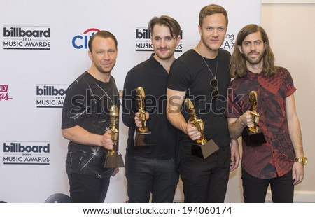 LAS VEGAS - MAY 18 : Members of the alternative rock band Imagine Dragons attend the 2014 Billboard Music Awards press room at the MGM Grand Garden Arena on May 18 , 2014 in Las Vegas.  - stock photo