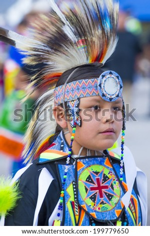 LAS VEGAS - MAY 24 : Native American boy takes part at the 25th Annual Paiute Tribe Pow Wow on May 24 , 2014 in Las Vegas Nevada. Pow wow is native American cultural gathernig event. - stock photo
