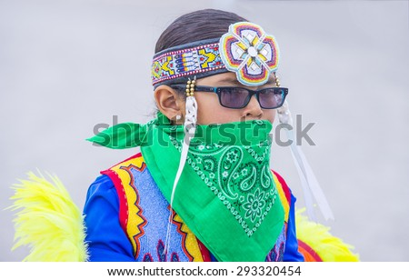 LAS VEGAS - MAY 24 : Native American boy takes part at the 26th Annual Paiute Tribe Pow Wow on May 24 , 2015 in Las Vegas Nevada. Pow wow is native American cultural gathernig event. - stock photo