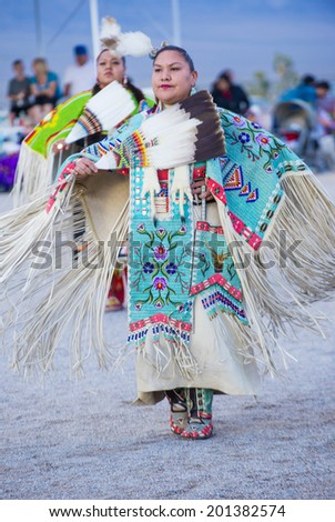 LAS VEGAS - MAY 24 : Native American women takes part at the 25th Annual Paiute Tribe Pow Wow on May 24 , 2014 in Las Vegas Nevada. Pow wow is native American cultural gathernig event. - stock photo