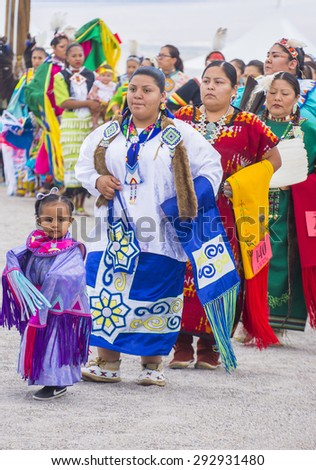LAS VEGAS - MAY 24 : Native American women takes part at the 26th Annual Paiute Tribe Pow Wow on May 24 , 2015 in Las Vegas Nevada. Pow wow is native American cultural gathernig event.