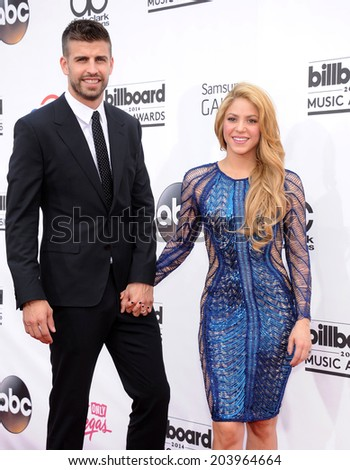 LAS VEGAS - MAY 18:  Shakira & Gerard Pique arrives to the Billboard Music Awards 2014  on May 18, 2014 in Las Vegas, NY                 - stock photo