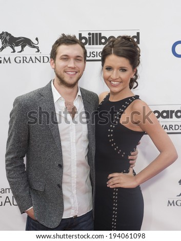 LAS VEGAS - MAY 18 :  Singer/songwriter Phillip Phillips (L) and Hannah Blackwell attend the 2014 Billboard Music Awards at the MGM Grand Garden Arena on May 18 , 2014 in Las Vegas.