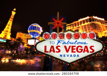 LAS VEGAS - MAY 12 : Welcome to fabulous Las Vegas neon sign with Las Vegas strip road background View of the strip on May 12, 2015 - stock photo
