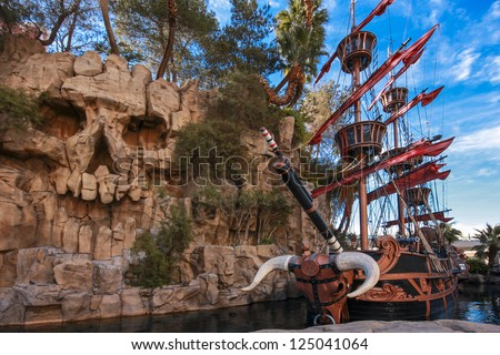 LAS VEGAS, NEVADA - APRIL 11, 2011: Pirate ship at pond near Treasure Island hotel in Las Vegas on April 11, 2011. This Caribbean themed resort has an hotel with 2,884 rooms - stock photo