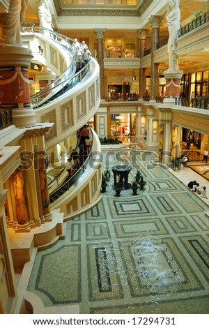 """Las Vegas, Nevada - 05 August 2008: """"The Forum Shops""""; mall connected to Caesars Palace; extension wing of main casino; simulates ancient Roman streets including fountains, statues and facades. - stock photo"""