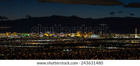 Las Vegas Nevada - December 13 : Famous Las Vegas Strip after dark with a bright neon and bright light glow from the hotels and casinos. December 13 2014 in Las Vegas, Nevada - stock photo