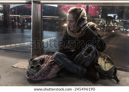 Las Vegas Nevada - December 18 : Homeless woman sitting on an overpass with her cat, December 18 2014 in Las Vegas, Nevada - stock photo