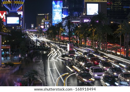 LAS VEGAS, NEVADA - December, 26, 2013:  Night view of heavy tourist traffic on the Las Vegas strip. - stock photo
