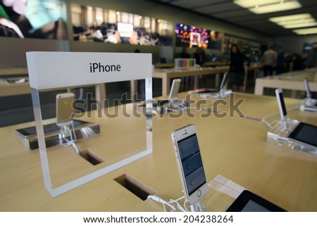 LAS VEGAS, NEVADA - FRI. JUNE 27, 2014:  People  shop at an Apple Computer retails store in Las Vegas, Nevada, on Friday, June, 27, 2014.  - stock photo