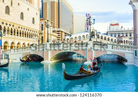 LAS VEGAS, NEVADA - JULY 17: Venice ressort with gondola on July 17, 2008 in Las Vegas, USA. The luxury resort has a five-diamond hotel with 4,049 suites and 4,059 hotel rooms - stock photo