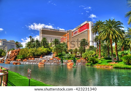 LAS VEGAS, NEVADA - MAY 16 : Colorful HDR image of The Mirage Hotel in Las Vegas on May 16 2016. Was opened in 1989, and has 2.884 rooms and a casino with 100,000 square feet  - stock photo