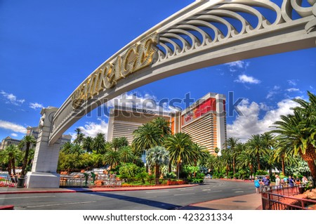 LAS VEGAS, NEVADA - MAY 16 : Colorful HDR image of The Mirage Hotel with its entrance gate in Las Vegas on May 16 2016. Was opened in 1989, and has 2.884 rooms and a casino with 100,000 square feet  - stock photo