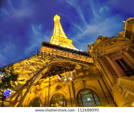 LAS VEGAS, NEVADA - MAY 7: Landmark Paris Hotel and Casino in Las Vegas, Nevada as seen at night on May 7, 2012. Stretching 4.2 miles, the Strip is home to the largest hotels and casinos in the world - stock photo