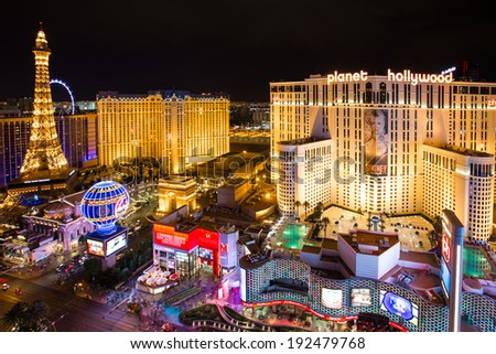 LAS VEGAS, NEVADA - MAY 7, 2014: Las Vegas Strip at night with brightly lit hotel resorts and casinos.  Over 39.7 million people visit Las Vegas each year.