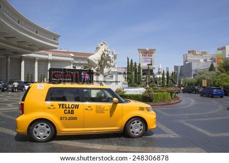 LAS VEGAS, NEVADA - MAY 9, 2014: Las Vegas Yellow Cab at the front of Caesars Palace Las Vegas Hotel & Casino. - stock photo