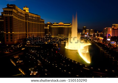 LAS VEGAS, NEVADA - 17 MAY 2013 - the fountains of the Bellagio Resort perform throughout the evening. The fountains are lit from below to ensure visitors to Las Vegas Boulevard can see the display. - stock photo