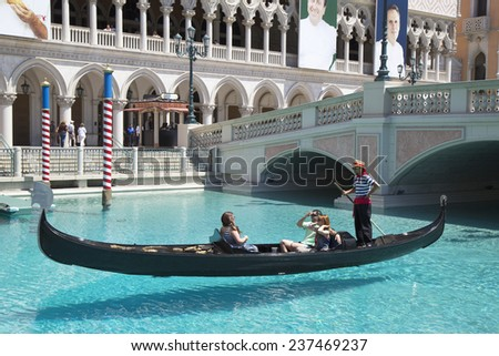 LAS VEGAS, NEVADA - MAY 10: Unidentified people enjoy gondola ride at Grand Canal at The Venetian Resort Hotel Casino on May 10, 2014. This luxury hotel opened in 1999 on Las Vegas Strip