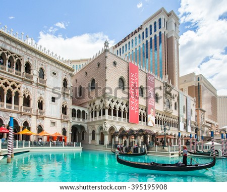 LAS VEGAS, NEVADA - MAY 7, 2014:  Venetian Palazzo Resort Casino with Grand Canal and gondola in view. This luxury hotel opened in 1999.