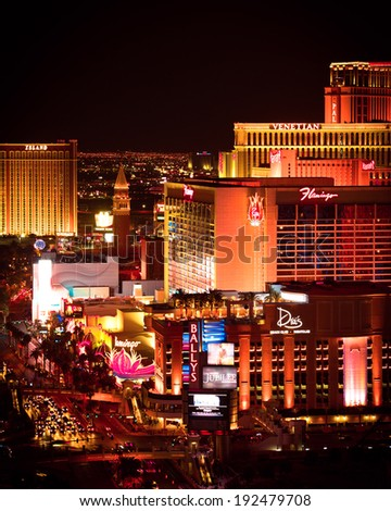 LAS VEGAS, NEVADA - MAY 7, 2014:  View across Las Vegas Strip at night with brightly lit hotel resorts and casinos.  Over 39.7 million people visit Las Vegas each year. - stock photo