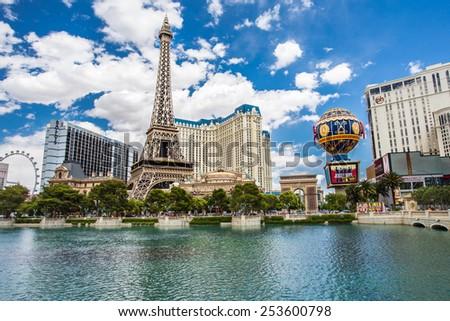 LAS VEGAS, NEVADA - MAY 7, 2014:  View of Las Vegas resorts, including Paris Las Vegas, Ballys and Planet Hollywood from across Bellagio Lagoon. - stock photo