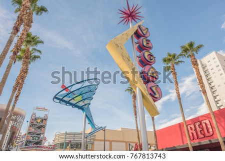 Las Vegas, Nevada, Nov. 21, 2017: The historic Vegas and Martini Glass neon signs rise above Fremont Street, downtown Las Vegas. Downtown is known for its beautiful, historical refurbished neon signs.