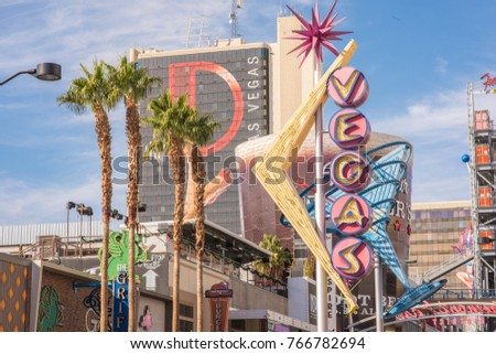 Las Vegas, Nevada, November 24, 2017: The bright, interesting and historic Vegas neon sign on display downtown near the Fremont Street Experience. The area is known for its unique art culture.