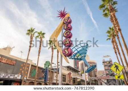 Las Vegas, Nevada, November 21, 2017: The giant Vegas and Martini Glass neon signs that hang above downtown Las Vegas, famous for their historical significance and colorful skyline contribution.
