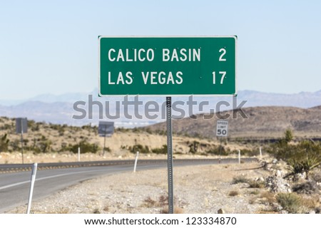 Las Vegas Nevada road sign with Las Vegas Valley in the background.