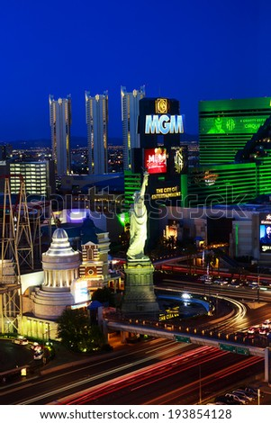 Las Vegas, Nevada, USA - April 3, 2013:  Evening picture with deep blue sky, from elevated level, of the  Las Vegas Strip MGM and New York Casino.  Long Exposure with cars lights lines. - stock photo