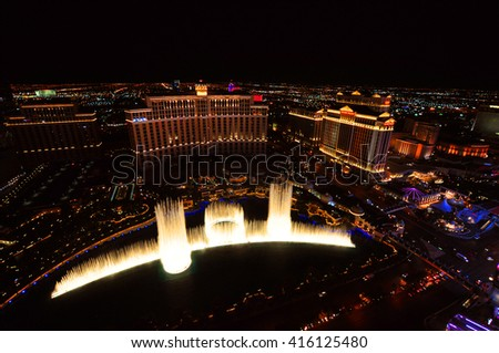 LAS VEGAS, NEVADA, USA - APRIL 22, 2015: Musical fountains at Bellagio Hotel & Casino on April 22, 2015 in Las Vegas. The Bellagio opened October 15, 1998, it was the most expensive hotel ever built. - stock photo