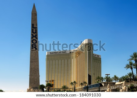LAs VEGAS, NEVADA/USA - AUGUST 1 ; View of the Replica Cleopatra's needle at the Luxor Hotel with the Mandalay Bay Hotel behind it  in Las Vegas Nevada on August 1, 2011