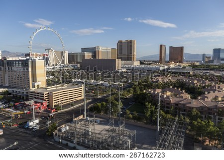 LAS VEGAS, NEVADA, USA - June 10, 2015:  Clear desert morning view of resort casino towers and the High Roller ferris wheel attraction.