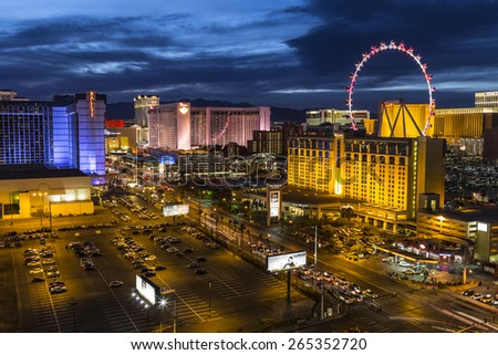 LAS VEGAS, NEVADA, USA - March 22, 2015:  Twilight at Las Vegas strip resorts and High Roller Ferris Wheel. - stock photo