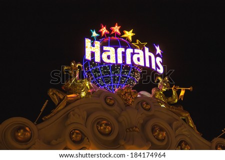 LAS VEGAS, NEVADA, USA - OCTOBER 23, 2013 : Harrah's Hotel and Casino Sign  in Las Vegas, Harrahs casino features over 1,200 slot machines, 80 table games, Keno, Bingo and a sports book.  - stock photo