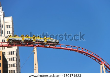 LAS VEGAS, NEVADA, USA - OCTOBER 21, 2013 : Tourists ride on a roller coaster in Las Vegas, The whole industry in Las Vegas is built on a variety of different entertainment