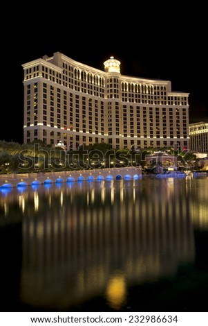 Las Vegas, Nevada, USA - Sept. 25, 2014: Buildings at the Bellagio casino and hotel reflecting in the fountain lake a night along the Las Vegas Blvd in Las Vegas, Nevada, USA on Sept. 25, 2014 - stock photo